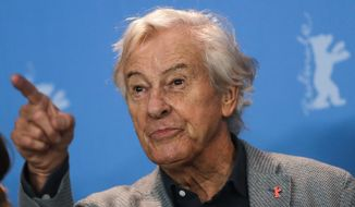 Paul Verhoeven, president of the Jury of the 67th International Berlin Film Festival, gestures as he poses for media during a photo call at the 2017 Berlinale Film Festival in Berlin, Germany, Thursday, Feb. 9, 2017. (AP Photo/Markus Schreiber)