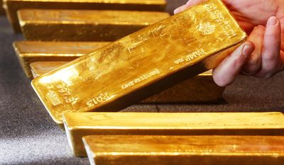 Various gold bars, are displayed in the German central bank's headquarters in Frankfurt, Germany, Thursday, Feb. 9, 2017.  Germany's central bank has completed an effort to bring home 300 tons of gold stashed in the United States, part of a plan to repatriate gold bars kept abroad during the Cold War.  (AP Photo/Michael Probst)