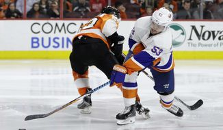 New York Islanders' Casey Cizikas, right, scores a goal as Philadelphia Flyers' Shayne Gostisbehere tries to defend during the third period of an NHL hockey game, Thursday, Feb. 9, 2017, in Philadelphia. New York won 3-1. (AP Photo/Matt Slocum)