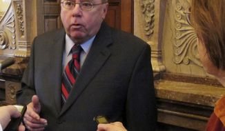 Kansas Senate Minority Leader Anthony Hensley, D-Topeka, answers questions from reporters after the Senate canceled a debate over budget-balancing proposals, Thursday, Feb. 9, 2017, at the Statehouse in Topeka, Kan. Hensley says GOP leaders should drop efforts to cut education funding to help balance the state budget (AP Photo/John Hanna)