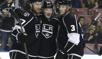 Los Angeles Kings' Tyler Toffoli, center, celebrates with Jeff Carter, left, and Brayden McNabb (3) after scoring a goal during the first period of an NHL hockey game against the Florida Panthers, Thursday, Feb. 9, 2017, in Sunrise, Fla. (AP Photo/Lynne Sladky)