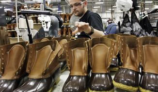 FILE - In this Dec. 14, 2011, file photo, Eric Rego stitches boots in the facility where LL Bean boots are assembled in Brunswick, Maine. L.L. Bean will freeze its pensions and offer an early retirement program in 2018 as it seeks to control growing expenses. Steve Smith, the Maine-based retailer's CEO, is making the announcement in a memo and in meetings with workers on Thursday, Feb. 9, 2017. (AP Photo/Pat Wellenbach, File)