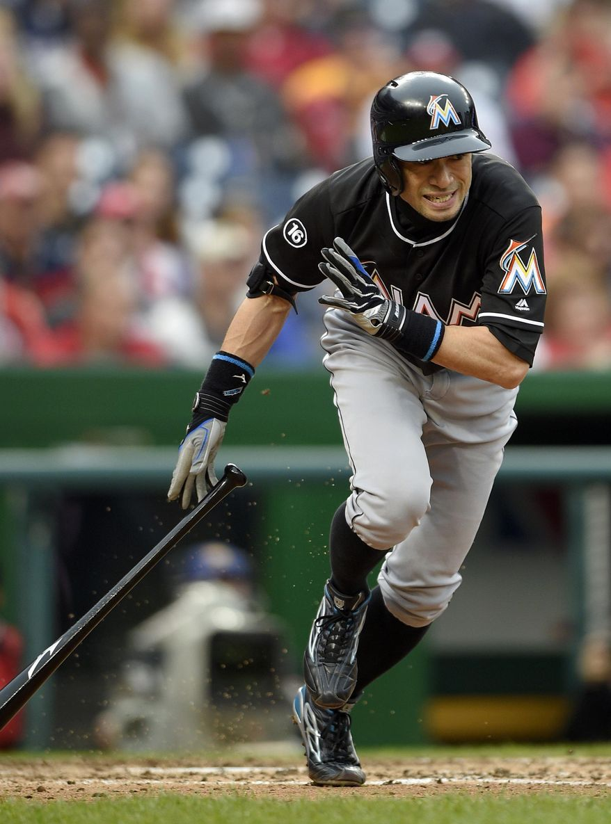 FILE - In this Oct. 1, 2016, file photo, Miami Marlins' Ichiro Suzuki, of Japan, runs towards first as he grounds out during the seventh inning of a baseball game against the Washington Nationals in Washington. The 43-year-old reserve outfielder returns this spring, and will build on his career total of 3,030 hits. (AP Photo/Nick Wass)