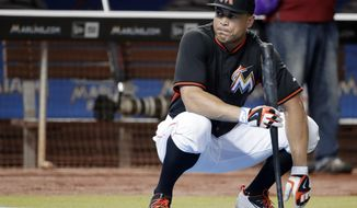 FILE - In this Sept. 6, 2016, file photo, Miami Marlins' Giancarlo Stanton watches batting practice before a baseball game against the Philadelphia Phillies in Miami. The Marlins lineup will again be anchored by $325 million slugger Giancarlo Stanton. (AP Photo/Lynne Sladky, File)