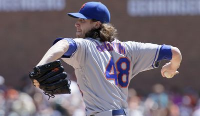 FILE - In this Aug. 7, 2016, file photo, New York Mets' Jacob deGrom pitches against the Detroit Tigers during an interleague baseball game, in Detroit. A healthy start. That's the main thing the Mets are hoping for this spring. deGrom underwent a September operation on the ulnar nerve in his right elbow(AP Photo/Duane Burleson, File)