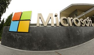 FILE - This July 3, 2014, file photo shows the Microsoft Corp. logo outside the Microsoft Visitor Center in Redmond, Wash. In a ruling released Thursday, Feb. 9, 2017, a federal judge declined to dismiss a lawsuit filed by Microsoft that claims a law that prohibits technology companies from telling customers when the government demands their electronic data is unconstitutional. (AP Photo/Ted S. Warren, File)