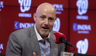 FILE - In this Nov. 18, 2015 file photo, Washington Nationals general manager Mike Rizzo speaks during a news conference at Nationals Park in Washington. Instead of revamping their roster after yet another early playoff exit, the Washington Nationals head to spring training next week counting on a bounce-back year from Bryce Harper and a full season from Stephen Strasburg.  (AP Photo/Carolyn Kaster) ** FILE **