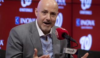 FILE - In this Nov. 18, 2015 file photo, Washington Nationals general manager Mike Rizzo speaks during a news conference at Nationals Park in Washington. Instead of revamping their roster after yet another early playoff exit, the Washington Nationals head to spring training next week counting on a bounce-back year from Bryce Harper and a full season from Stephen Strasburg.  (AP Photo/Carolyn Kaster, File)