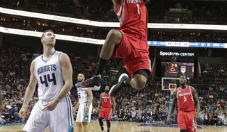 Houston Rockets' Trevor Ariza (1) dunks past Charlotte Hornets' Frank Kaminsky III (44) during the first half of an NBA basketball game in Charlotte, N.C., Thursday, Feb. 9, 2017. (AP Photo/Chuck Burton)