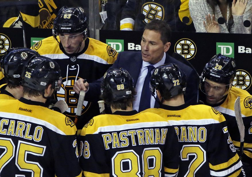 Boston Bruins interim head coach Bruce Cassidy, top right, talks to his players during a timeout in the third period of an NHL hockey game against the San Jose Sharks, Thursday, Feb. 9, 2017, in Boston.(AP Photo/Elise Amendola)