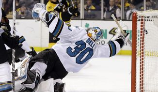 San Jose Sharks goalie Aaron Dell (30) dives for but cannot stop a goal by Boston Bruins right wing David Pastrnak, back left, in the second period of an NHL hockey game, Thursday, Feb. 9, 2017, in Boston. (AP Photo/Elise Amendola)