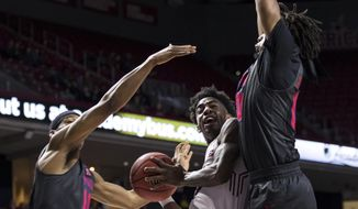 Temple's Quinton Rose, center, looks for a shot between SMU's Ben Moore, right, and Jarrey Foster during the first half of an NCAA college basketball game, Thursday, Feb. 9, 2017, in Philadelphia. (AP Photo/Chris Szagola)