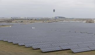 The solar farm at the Indianapolis International Airport is pictured, Wednesday, Feb. 8, 2017, in Indianapolis. Duke Energy and other utilities are backing measures in the Indiana Legislature and several other states that would eventually end the ability of small operators to produce solar power. (AP Photo/Darron Cummings)