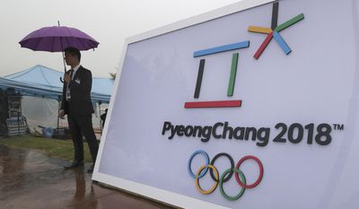 FILE - In this Sept. 27, 2016 file photo, security personnel stands by a logo of the 2018 PyeongChang Olympic Winter Games before an event to mark the start of the 500-day countdown in Seoul, South Korea. The head of analysis for Gracenote, a US-based sports and entertainment provider, is running a sophisticated computer program that predicts Norway, Germany and the US will lead the medal counts. (AP Photo/Lee Jin-man, File)