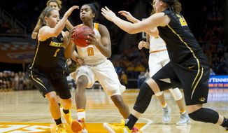 Tennessee's Jordan Reynolds (0) drives the ball into the paint past Missouri's Lianna Doty (1) and Missouri's Sierra Michaelis (24)during an NCAA college basketball game in Knoxville, Tenn., on Thursday, Feb. 9, 2017. (Calvin Mattheis/Knoxville News Sentinel via AP)