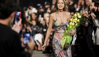 Gigi Hadid walks the runway at the Tommy Hilfiger TommyxGigi Runway Show at Venice Beach on Wednesday, Feb. 8, 2017, in Los Angeles. (Photo by Rich Fury/Invision/AP)