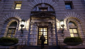 A man walks up the steps of the 9th U.S. Circuit Court of Appeals building Thursday, Feb. 9, 2017, in San Francisco. A federal appeals court refused Thursday to reinstate President Donald Trump's ban on travelers from seven predominantly Muslim nations, dealing another legal setback to the new administration's immigration policy. (AP Photo/Marcio Jose Sanchez)