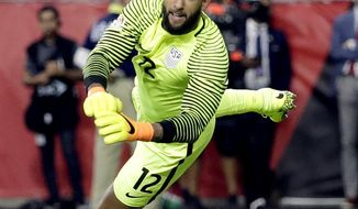 FILE - In this June 25, 2016, file photo, United States goalkeeper Tim Howard (12) stops a shot on goal against Colombia during the second half of the Copa America Centenario third-place soccer match at University of Phoenix Stadium in Glendale, Ariz. Howard may return from leg surgery in time for next month's World Cup qualifiers against Honduras and Panama, according to U.S. coach Bruce Arena. (AP Photo/Matt York, File)