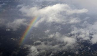 A rainbow is seen from the air, Thursday, Feb. 9, 2017, north of Seattle near Woodinville, Wash. Sun breaks and rain were the rule of the day for the Seattle area, while snow and ice gripped cities further north. (AP Photo/Ted S. Warren)