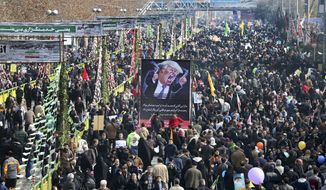 Iranians carry a banner showing a caracature of U.S. President Donald Trump during an annual rally commemorating the anniversary of the 1979 Islamic revolution, which toppled the late pro-U.S. Shah, Mohammad Reza Pahlavi, in Tehran, Iran, Friday, Feb. 10, 2017. (AP Photo/Ebrahim Noroozi)