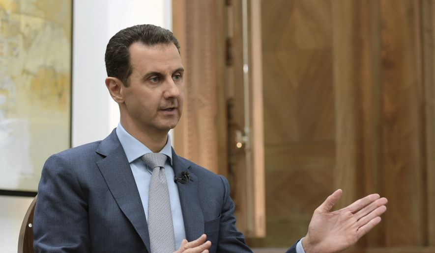 In this photo released by the Syrian official news agency SANA, Syrian President Bashar Assad speaks during an interview with Yahoo News in Damascus, Syria, Friday, Feb. 10, 2017. (SANA via AP)