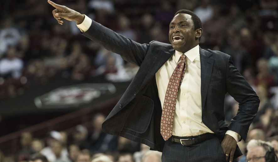 Alabama coach Avery Johnson gestures to players during the first half of the team's NCAA college basketball game against South Carolina on Tuesday, Feb. 7, 2017, in Columbia, S.C. (AP Photo/Sean Rayford)