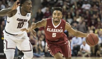 Alabama guard Avery Johnson Jr. (5) dribbles against South Carolina guard Duane Notice (10) during the second half of an NCAA college basketball game Tuesday, Feb. 7, 2017, in Columbia, S.C. Alabama defeated South Carolina 90-86. (AP Photo/Sean Rayford)