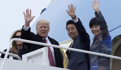 President Donald Trump and Japanese Prime Minister Shinzo Abe, accompanied by their wives, first lady Melania Trump and Akie Abe, wave before boarding Air Force One at Andrews Air Force Base Md., Friday, Feb. 10, 2017. Trump is hosting Abe at his estate Mar-a-Lago in Palm Beach, Fla., for the weekend. (AP Photo/Susan Walsh)