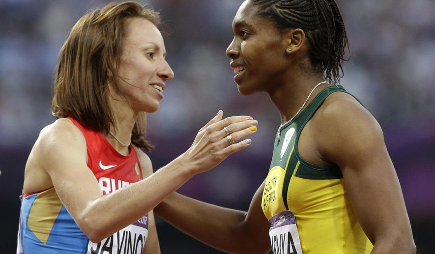 FILE - In this Aug. 11, 2012 file photo Russia's Mariya Savinova, left, is congratulated by South Africa's second placed Caster Semenya after winning the women's 800-meter final during the athletics in the Olympic Stadium at the 2012 Summer Olympics, London. Savinova has been banned for four years for doping by the Court of Arbitration for Sport on Friday, Feb. 10, 2017 and stripped of the Olympic gold medal from 2012.  (AP Photo/Anja Niedringhaus, file)