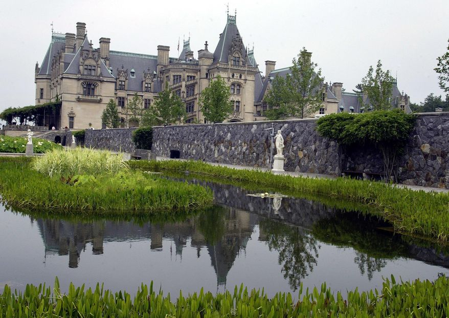 FILE- In this July 6, 2005, file photo, the Biltmore House is reflected in a pond on the estate in Asheville, N.C. Buncombe County appraisers say Biltmore House is worth about $37 million, and the nearly 2,200 acres it sits on is worth more than $64 million. The tax department says if you throw in the hotels, restaurants, outbuildings and private residences, the total value of the public areas of Biltmore Estate is nearly $300 million. (AP Photo/Chuck Burton, File)