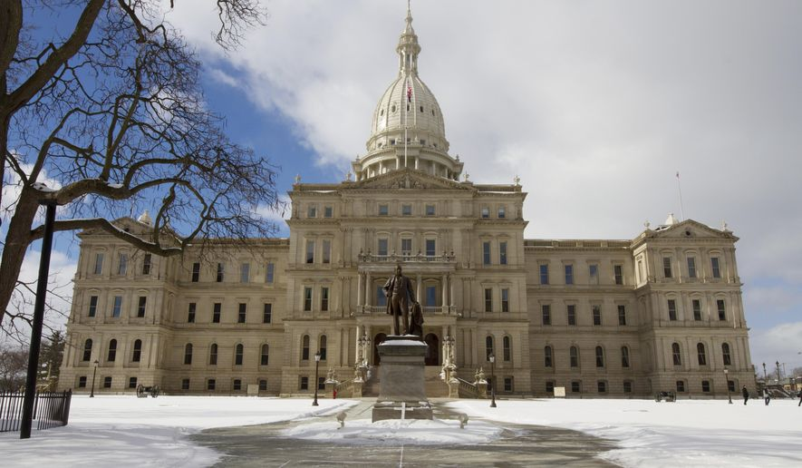 In a photo from Feb. 2, 2017, Michigan's State House is seen in Lansing, Mich. The Michigan Capitol's aging infrastructure is starting to wear down. Out of sight behind the walls and beneath the floors, significant repairs and upgrades are needed to much of the Capitol's plumbing, electrical, mechanical and fire suppression systems. The first and last major renovation and restoration project was almost 30 years ago when equipment and new systems were installed, but they have not been updated since. (AP Photo/Christopher Ehrmann)
