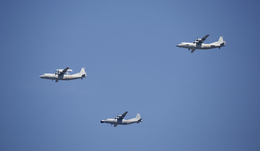"""FILE - In this Sept. 3, 2015 file photo, a KJ-200 airborne early warning and control plane, left, a Y-8J radar plane, center, and a Y-9JB radar plane, right, fly in formation during a parade commemorating the 70th anniversary of Japan's surrender during World War II in Beijing. The U.S. Pacific Command says a Chinese aircraft and a U.S. Navy patrol plane had an """"unsafe"""" encounter over the South China Sea this week, raising concerns. Pacific Command spokesman Robert Shuford said Friday, Feb. 10, 2017, that the """"interaction"""" between a Chinese KJ-200 early warning aircraft and a U.S. Navy P-3C plane took place on Wednesday, Feb. 8, in international airspace over the waters. (AP Photo/Mark Schiefelbein, File)"""