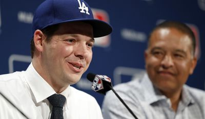 FILE - In this Dec. 5, 2016, file photo, Los Angeles Dodgers pitcher Rich Hill, left, speaks as manager Dave Roberts looks on during a media availability at Major League Baseball's winter meetings, in Oxon Hill, Md. After coming within two games of reaching the World Series, the Los Angeles Dodgers had a simple plan going into the offseason: keep their roster intact and make a couple of additions. They re-signed key free agents Kenley Jansen, Justin Turner and Rich Hill.(AP Photo/Alex Brandon, File)