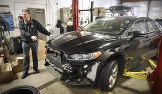 FOR RELEASE MONDAY, FEBRUARY 13, 2017, AT 12:01 A.M. CST.- This photo taken Dec. 16, 2016, shows Peters Body Shop chief financial officer Glen Sunder talking about processes used to repair vehicles at the business in St. Cloud, Minn. (Dave Schwarz/The St. Cloud Times via AP)