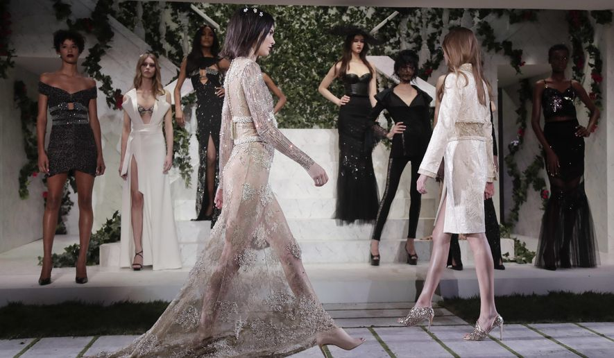 Kendall Jenner, left, models the La Perla fashion collection during Fashion Week, Thursday, Feb. 9, 2017, in New York. (AP Photo/Julie Jacobson)