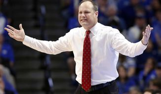 FILE - In this Jan. 31, 2017, file photo, Georgia head coach Mark Fox reacts to a play during the second half of an NCAA college basketball game against Kentucky, in Lexington, Ky. Georgia, which has fallen to 12th in the SEC, is quickly running out of time to salvage its season, and that could be bad news for coach Mark Fox, who was expected to have enough talent to take the Bulldogs to the NCAA tournament. (AP Photo/James Crisp, File)