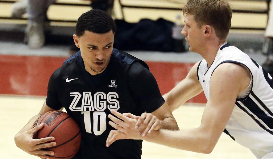Gonzaga guard Bryan Alberts, left, is fouled by Loyola Marymount's Erik Johansson during the second half of an NCAA college basketball game in Los Angeles, Thursday, Feb. 9, 2017. Gonzaga won 90-60. (AP Photo/Chris Carlson)