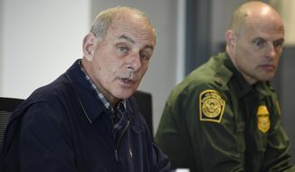 Secretary of Homeland Security John Kelly (left) speaks as Chief of United States Border Patrol Ronald Vitiello, right, looks on during a meeting held at the San Ysidro Port of Entry in San Diego on Feb. 10, 2017. (AP Photo/Denis Poroy, Pool) **FILE**