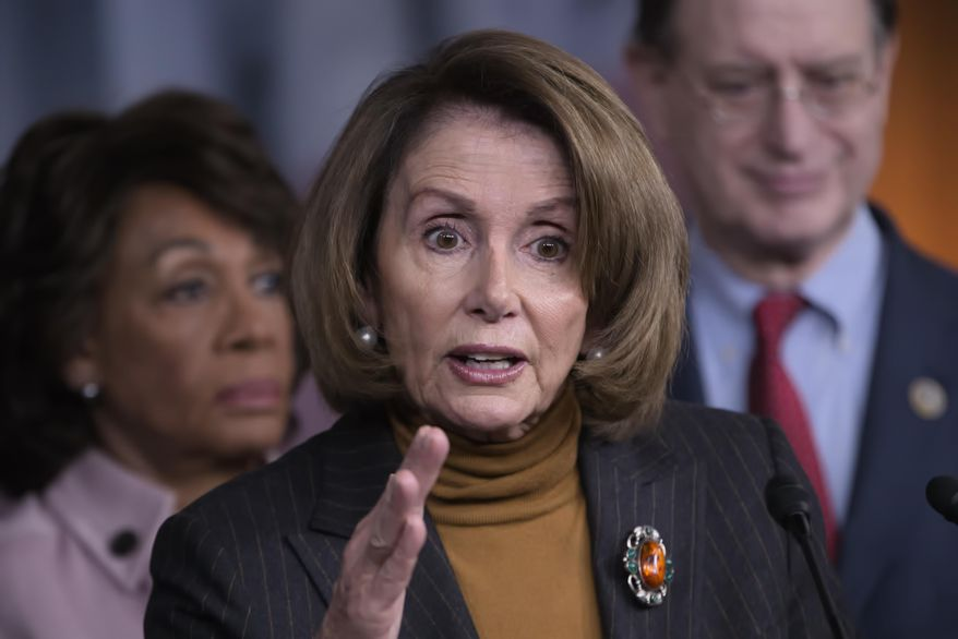 House Minority Leader Nancy Pelosi of Calif., center, joined by Rep. Maxine Waters, D-Calif., left, and Rep. Brad Sherman, D-Calif. speaks during a news conference on Capitol Hill in Washington, in this Feb. 6, 2017, file photo. (AP Photo/J. Scott Applewhite, File)
