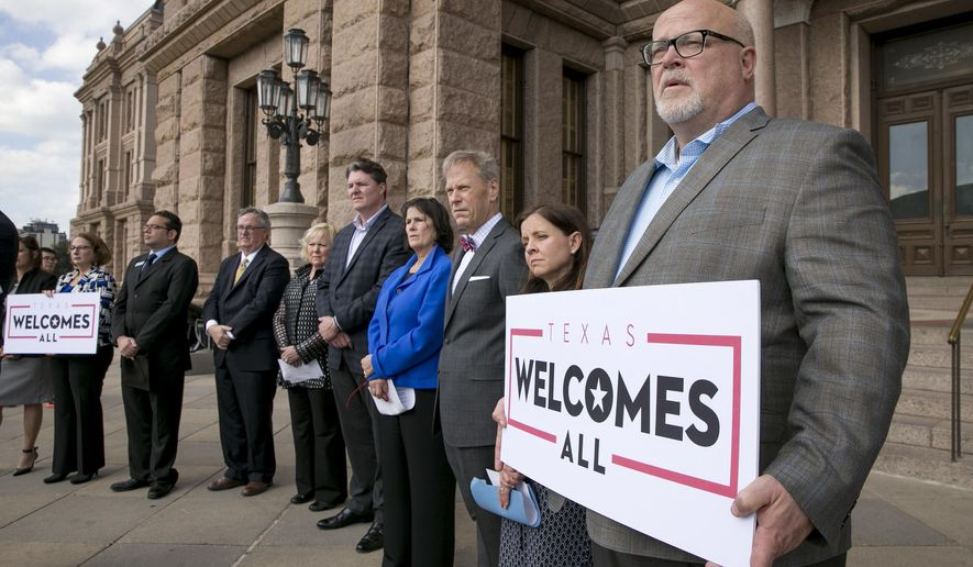 "In this Jan. 11, 2017, file photo, Brad Kent, Chief Sales and Services Officer for Visit Dallas, holds a sign at a news conference at the Capitol in Austin, Texas, to oppose a Texas ""bathroom bill."" The NFL is expressing sharper warnings about a Texas ""bathroom bill"" targeting transgender persons than statements prior to the Super Bowl in Houston. NFL spokesman Brian McCarthy on Friday, Feb. 10, 2017,  raised the prospect of Texas losing out on future Super Bowls if there were laws ""discriminatory or inconsistent with our values,: He said such measures ""would certainly be a factor"" taken into consideration. (Jay Janner/Austin American-Statesman via AP, File)"