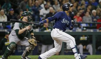 FILE - In this Oct. 1, 2016, file photo, Seattle Mariners' Robinson Cano watches his two-run home run against the Oakland Athletics during the fifth inning of a baseball game, in Seattle. Another flurry of offseason moves have left the Mariners a significantly remodeled club headed to Arizona. (AP Photo/Ted S. Warren, File)