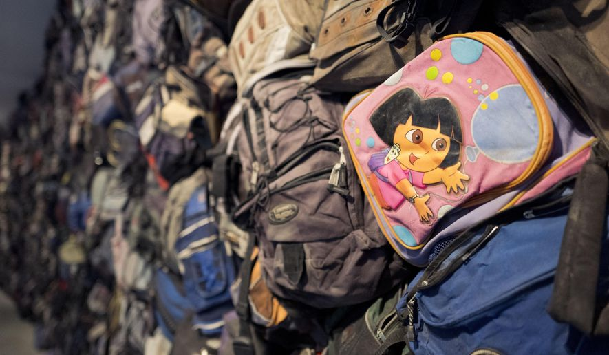 "A Dora the Explorer backpack is one of hundreds of backpacks left behind by migrants illegally crossing the U.S.-Mexican border on display in the ""State of Exception"" exhibit, Friday, Feb. 10, 2017 in New York. The exhibit at the Sheila C. Johnson Design Center at the Parsons School of Design continues through April 17. (AP Photo/Mark Lennihan)"
