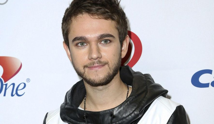 "FILE - This Dec. 4, 2015 file photo shows DJ and producer Zedd at 106.1 KISS FM's iHeartRadio Jingle Ball in Los Angeles.  Zedd, a Russian-born immigrant whose real name is Anton Zaslavski, has organized a concert called, ""Welcome!"", on April 3, 2017, to benefit the American Civil Liberties Union. The organization has been fighting President Donald Trump's executive order on immigration, which included a temporary travel ban on people from seven Muslim-majority countries. (Photo by Rich Fury/Invision/AP, File)"