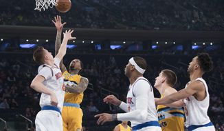 Denver Nuggets forward Wilson Chandler shoots over New York Knicks forward Kristaps Porzingis during the first half of an NBA basketball game, Friday, Feb. 10, 2017, at Madison Square Garden in New York. (AP Photo/Mary Altaffer)