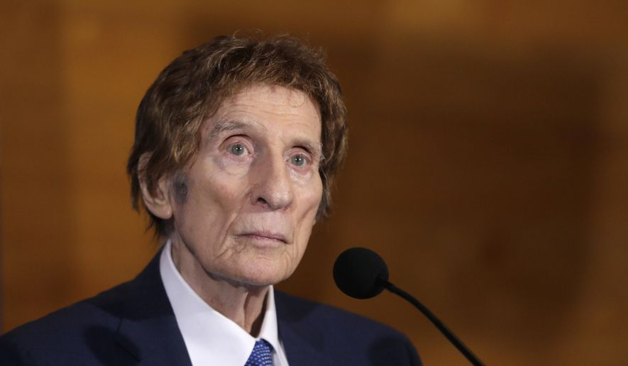 FILE- In a file photo from Nov. 14, 2014, Detroit Tigers owner Mike Ilitch listens during a news conference in Detroit. Ilitch, the owner of the Detroit Red Wings and Tigers, who founded the Little Caesars Pizza empire, has died. He was 87. Family spokesman Doug Kuiper says Ilitch died Friday, Feb. 10, 2017, at a hospital in Detroit. Ilitch and his wife opened their first Little Caesars restaurant in suburban Detroit in 1959, and the business eventually grew into the world's largest carry-out pizza chain. (AP Photo/Carlos Osorio, File)