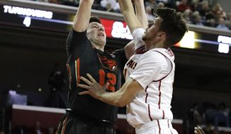 Oregon State's Drew Eubanks, left, has his shot blocked by Southern California's Nick Rakocevic during the first half of an NCAA college basketball game, Thursday, Feb. 9, 2017, in Los Angeles. (AP Photo/Jae C. Hong)