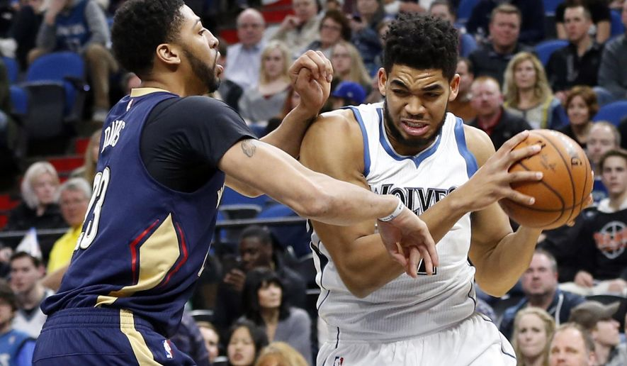 Minnesota Timberwolves' Karl-Anthony Towns, right, works around New Orleans Pelicans' Anthony Davis during the first quarter of an NBA basketball game Friday, Feb. 10, 2017, in Minneapolis. (AP Photo/Jim Mone)