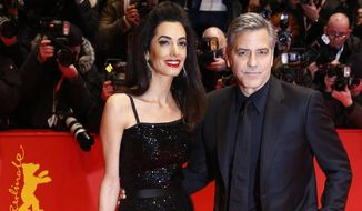 "This Feb. 11, 2016 file photo shows Amal Clooney, left, and George Clooney at the red carpet for ""Hail, Caesar!"" the opening film of the 2016 Berlinale Film Festival in Berlin, Germany. The Clooneys are expecting twins in June, Julie Chen said Thursday on CBS' ""The Talk."" George Clooney told Chen in late January that his wife, a human rights attorney, was pregnant, ""The Talk"" host said. (AP Photo/Axel Schmidt, File)"