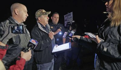 St. Charles Parish Sheriff Greg Champagne speaks to members of the media about a fire at the Phillips 66 pipeline in Paradis, La., Thursday, Feb. 9, 2017. Authorities don't yet know what caused the fire on the pipeline, but several workers was cleaning it at the time, Champagne said at a news conference. (Brett Duke/NOLA.com The Times-Picayune via AP)
