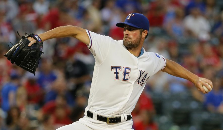 FILE - In this Sept. 16, 2016, file photo, Texas Rangers starting pitcher Cole Hamels works against the Oakland Athletics in the second inning of a baseball game in Arlington, Texas. Hamels and Yu Darvish, the Rangers two aces, are set to start a season in the rotation together for the first time. (AP Photo/Tony Gutierrez, File)